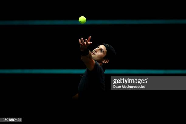 Marcos Giron of USA serves in his match against Andrey Rublev of Russia during Day 2 of the 48th ABN AMRO World Tennis Tournament at Ahoy on March...
