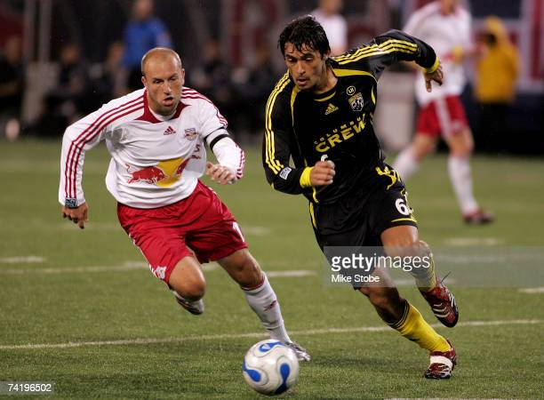 Marcos Gonzalez of the Columbus Crew and Clint Mathis of the New York Red Bulls battle for the ball at Giants Stadium in the Meadowlands on May 19...