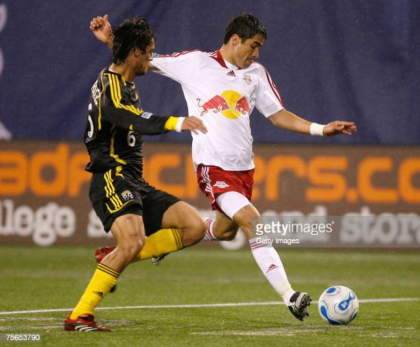 Marcos Gonzalez of the Columbus Crew and Juan Pablo Angel of the New York Red Bulls battle for the ball at Giants Stadium in the Meadowlands on May...