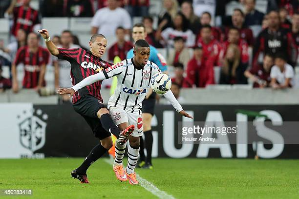 Marcos Guilherme of AtleticoPR competes for the ball with Malcom of Corinthians during the match between AtleticoPR and Corinthians for the Brazilian...