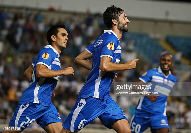 Marcos Gullon from Apollon Limassol FC celebrates scoring a goal against FC Zurich with teammates Joao Paulo and Bertrand Robert in their UEFA Europa...