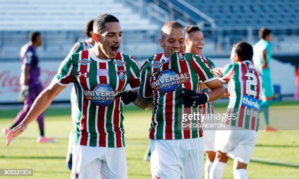 Marcos Junior of Brazilian club Fluminense celebrates with teammate Gilberto after scoring a goal in the first half against Barcelona SC of Ecuador...