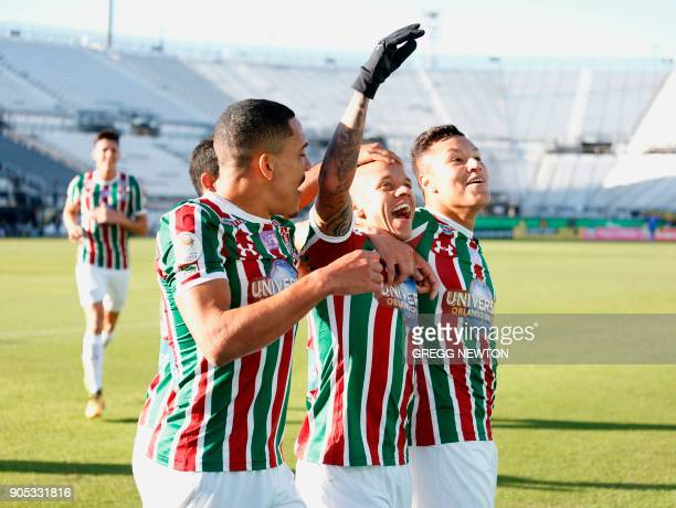 Marcos Junior of Brazilian club Fluminense celebrates with teammates after scoring a goal in the first half against Barcelona SC of Ecuador during...
