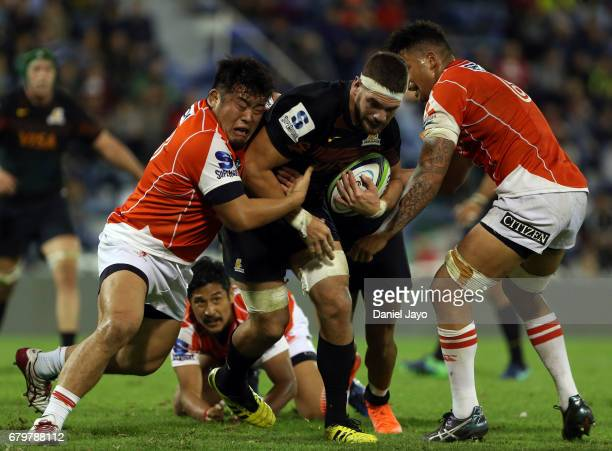 Marcos Kremer of Jaguares is tackled by Takuma Asahara of Sunwolves during a match between Jaguares v Sunwolves as part of Super Rugby Rd 11 at Jose...
