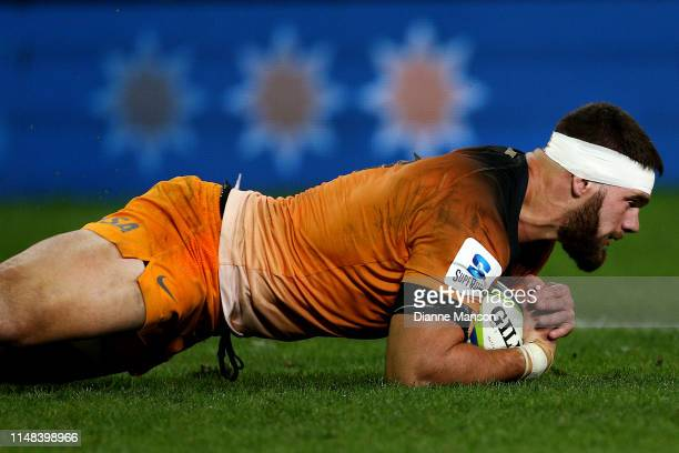 Marcos Kremer of the Jaguares dives over to score a try during the round 13 Super Rugby match between the Highlanders and the Jaguares at Forsyth...