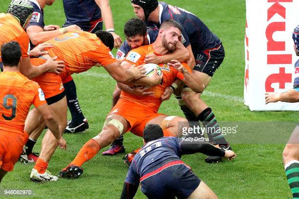 Marcos Kremer of the Jaguares is tackled by Rebels defence during the round nine Super Rugby match between the Rebels and the Jaguares at AAMI Park...