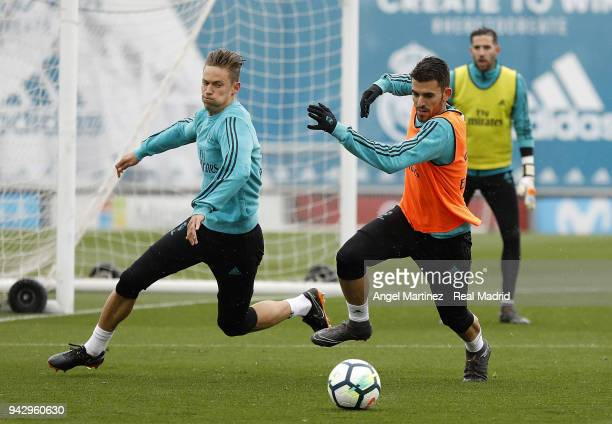 Marcos Llorente and Dani Ceballos of Real Madrid in action during a training session at Valdebebas training ground on April 7 2018 in Madrid Spain
