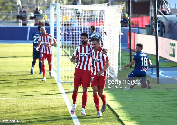 Marcos Llorente and Diego Costa of Atletico Madrid celebrate their first goal during the Liga match between Levante UD and Club Atletico de Madrid at...