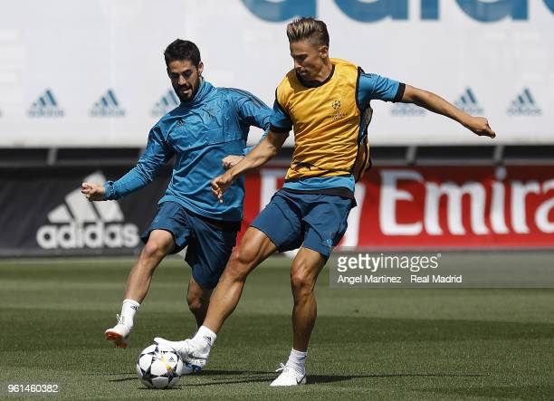Marcos Llorente and Isco of Real Madrid in action during a training session at Valdebebas training ground on May 22 2018 in Madrid Spain