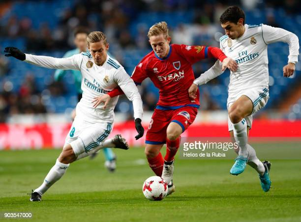 Marcos Llorente Jesus Vallejo of Real Madrid and Dani Nieto of Numancia compete for the ball during the Copa del Rey round of 16 second leg match...