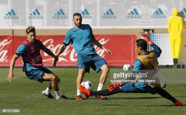Marcos Llorente Karim Benzema and Keylor Navas of Real Madrid in action during a training session at Valdebebas training ground on October 16 2017 in...