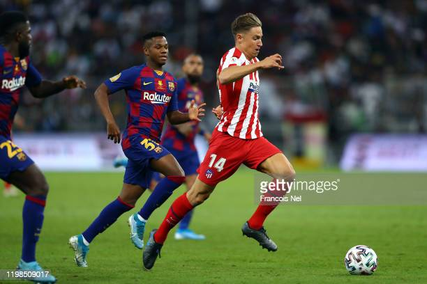 Marcos Llorente of Athletico Madrid in action during the Supercopa de Espana SemiFinal match between FC Barcelona and Club Atletico de Madrid at King...