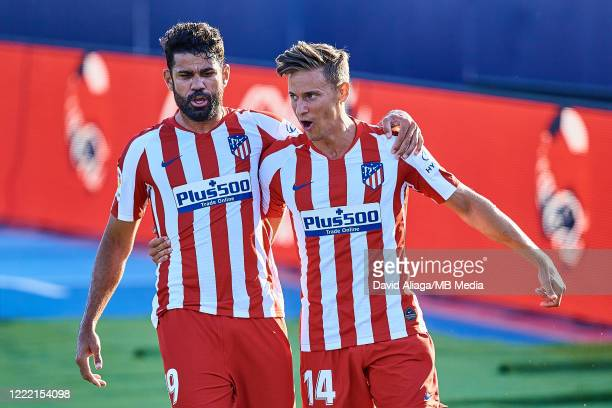 Marcos Llorente of Atletico de Madrid and his teammate Diego Costa celebrate a goal during the Liga match between Levante UD and Club Atletico de...