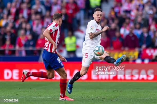 Marcos Llorente of Atletico de Madrid and Lucas Ocampos of Sevilla FC battle for the ball during the Liga match between Club Atletico de Madrid and...