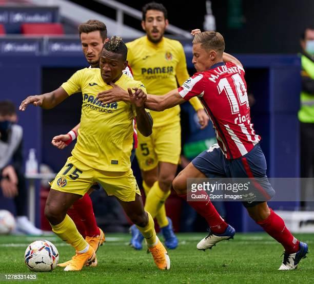 Marcos Llorente of Atletico de Madrid battle for the ball with Pervis Estupinan Villarreal CF during the La Liga Santader match between Atletico de...