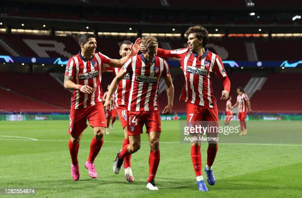 Marcos Llorente of Atletico de Madrid celebrates after he scores his team's first goal during the UEFA Champions League Group A stage match between...