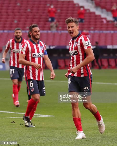 Marcos Llorente of Atletico de Madrid celebrates scoring their fourth goal with teammate Angel Martin Correa during the La Liga Santander match...