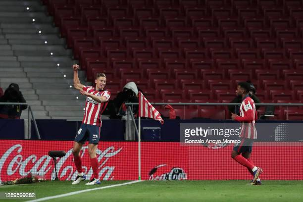 Marcos Llorente of Atletico de Madrid celebrates with team mate Thomas Lemar after scoring his sides second goal during the La Liga Santander match...