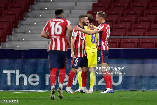 Marcos Llorente of Atletico de Madrid celebrates with teammate Koke after scoring his team's second goal during the La Liga Santander match between...