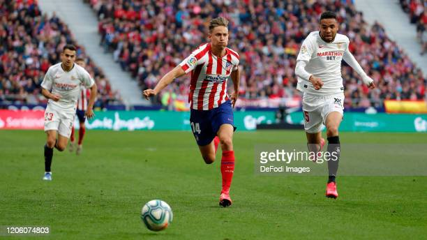 Marcos Llorente of Atletico de Madrid Jules Kounde of Sevilla FC battle for the ball during the Liga match between Club Atletico de Madrid and...