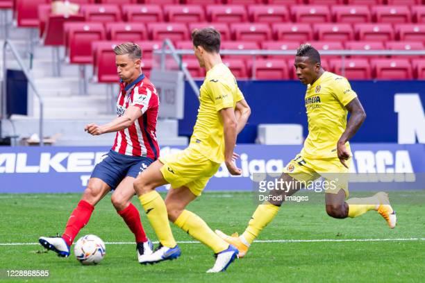Marcos Llorente of Atletico de Madrid Pau Torres of Villarreal CF and Pervis Estupinan of Villarreal CF battle for the ball during the La Liga...