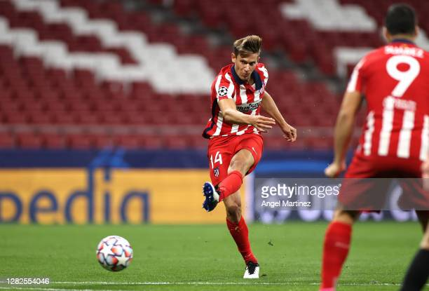 Marcos Llorente of Atletico de Madrid scores his team's first goal during the UEFA Champions League Group A stage match between Atletico Madrid and...