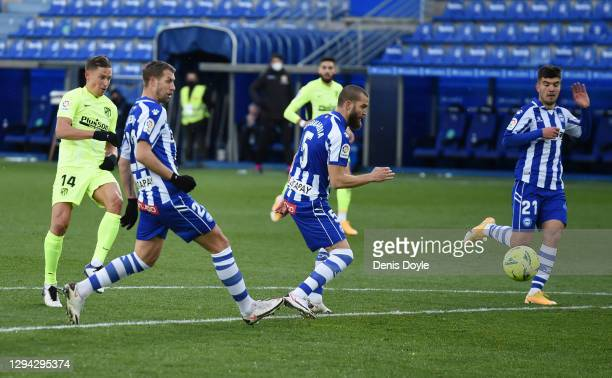Marcos Llorente of Atletico de Madrid scores their sides first goal during the La Liga Santander match between Deportivo Alavés and Atletico de...