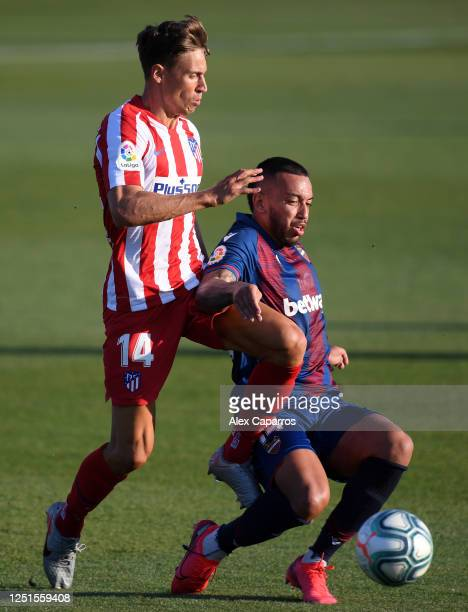 Marcos Llorente of Atletico Madrid and Ruben Vezo of Levante clash during the Liga match between Levante UD and Club Atletico de Madrid at Estadi...