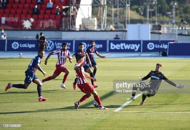Marcos Llorente of Atletico Madrid assists an own goal scored by Bruno Gonzalez of Levante during the Liga match between Levante UD and Club Atletico...