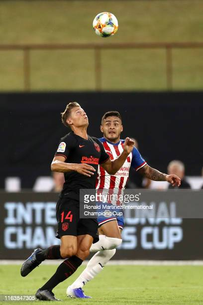Marcos Llorente of Atletico Madrid battles for the ball with Alexis Vega of Guadalajara during their 2019 International Champions Cup match at Globe...