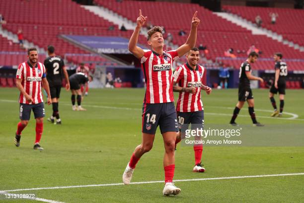 Marcos Llorente of Atletico Madrid celebrates after scoring their team's fourth goal during the La Liga Santander match between Atletico de Madrid...