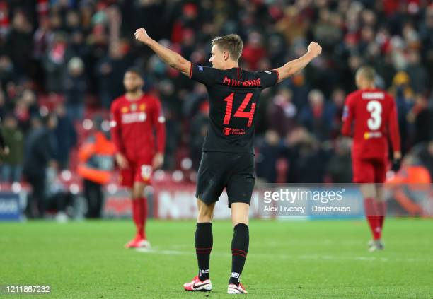 Marcos Llorente of Atletico Madrid celebrates after the UEFA Champions League round of 16 second leg match between Liverpool FC and Atletico Madrid...