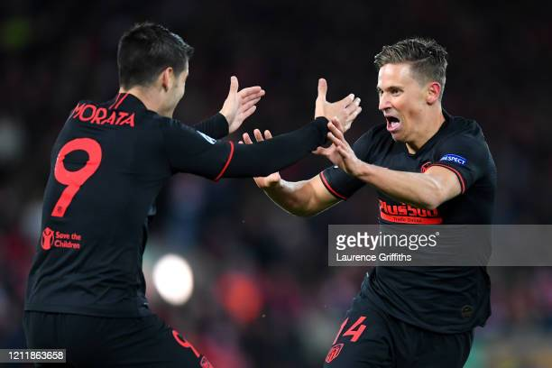 Marcos Llorente of Atletico Madrid celebrates with Alvaro Morata of Atletico Madrid after scoring his team's second goal during the UEFA Champions...