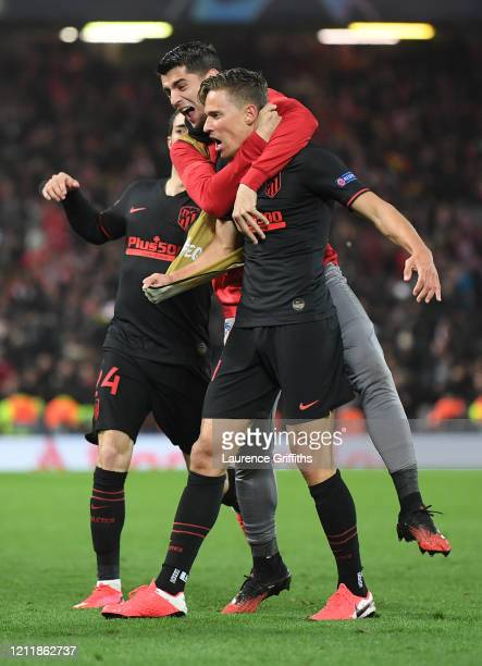 Marcos Llorente of Atletico Madrid celebrates with his team mates after scoring his team's first goal during the UEFA Champions League round of 16...