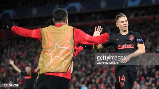 Marcos Llorente of Atletico Madrid celebrates with his team mates after scoring his team's second goal during the UEFA Champions League round of 16...