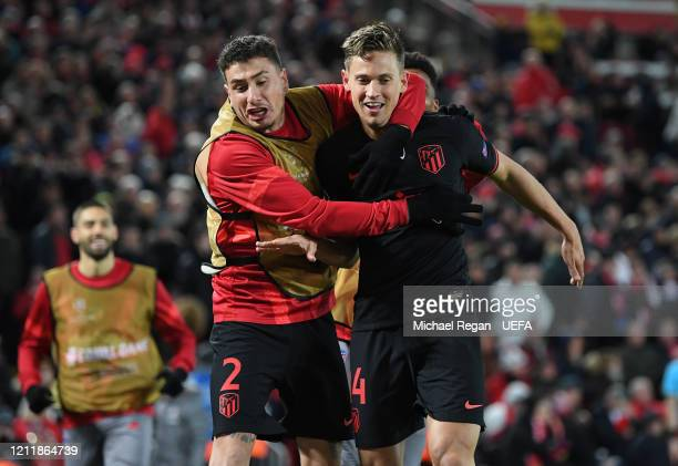 Marcos Llorente of Atletico Madrid celebrates with Jose Gimenez of Atletico Madrid after scoring his team's second goal during the UEFA Champions...