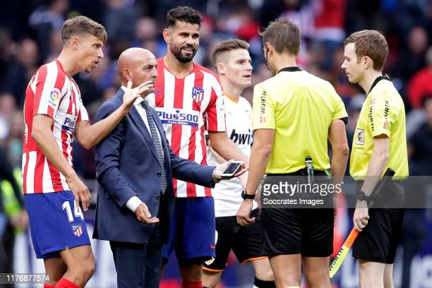 Marcos Llorente of Atletico Madrid Diego Costa of Atletico Madrid referee Cordero Vega during the La Liga Santander match between Atletico Madrid v...
