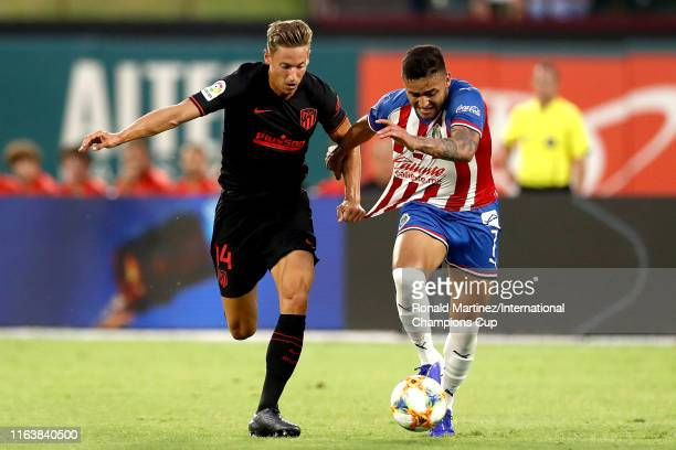 Marcos Llorente of Atletico Madrid fouls Alexis Vega of Guadalajara and is given a red card during their 2019 International Champions Cup match at...