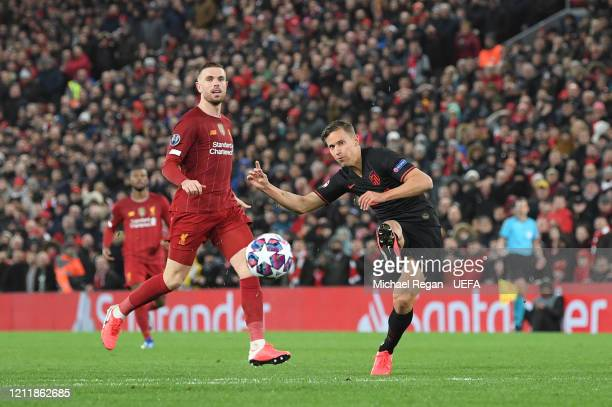 Marcos Llorente of Atletico Madrid scores his team's first goal during the UEFA Champions League round of 16 second leg match between Liverpool FC...