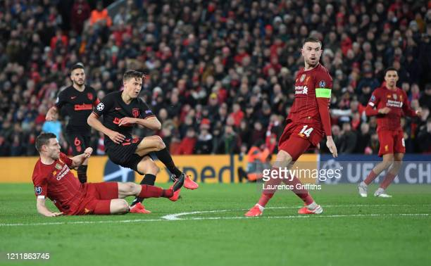 Marcos Llorente of Atletico Madrid scores his team's second goal during the UEFA Champions League round of 16 second leg match between Liverpool FC...