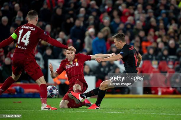 Marcos Llorente of Atletico Madrid scores his team's third goal during the UEFA Champions League round of 16 second leg match between Liverpool FC...