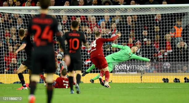 Marcos Llorente of Atletico Madrid scores past Adrian of Liverpool during the UEFA Champions League round of 16 second leg match between Liverpool FC...