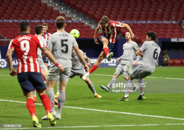 Marcos Llorente of Atletico Madrid scores their team's first goal during the La Liga Santander match between Atletico de Madrid and Athletic Club at...