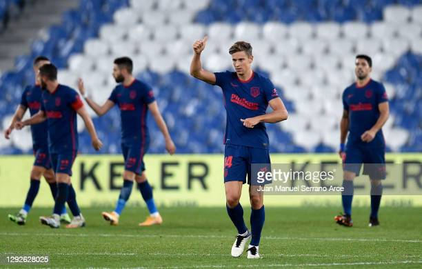 Marcos Llorente of Atlético Madrid celebrates after scoring their team's second goal during the La Liga Santander match between Real Sociedad and...