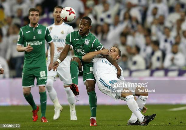 Marcos Llorente of Real Madrid competes for the ball with Claudio Beauvue of Leganes during the Spanish Copa del Rey Quarter Final Second Leg match...