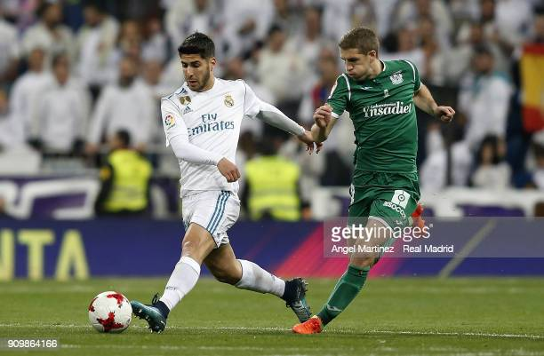 Marcos Llorente of Real Madrid competes for the ball with Darko Brasanac of Leganes during the Spanish Copa del Rey Quarter Final Second Leg match...