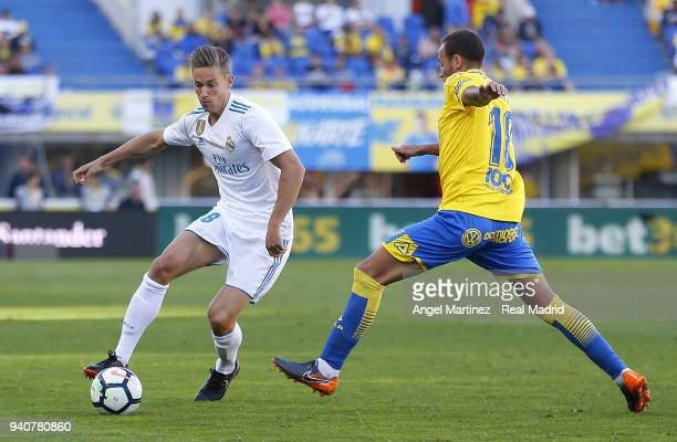 Marcos Llorente of Real Madrid competes for the ball with Javi Castellano of UD Las Palmas during the La Liga match between UD Las Palmas and Real...