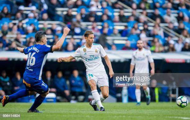 Marcos Llorente of Real Madrid fights for the ball with Daniel Alejandro Torres Rojas D Torres of Deportivo Alaves during the La Liga 201718 match...