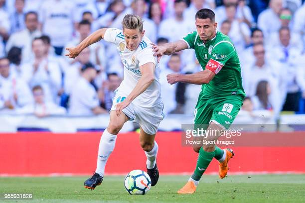 Marcos Llorente of Real Madrid fights for the ball with Gabriel Appelt Pires of CD Leganes during the La Liga 201718 match between Real Madrid and CD...