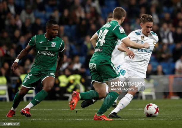 Marcos Llorente of Real Madrid in action against Claudio Beauvue and Darko Brasanac of Leganes during the Copa del Rey quarter final match between...